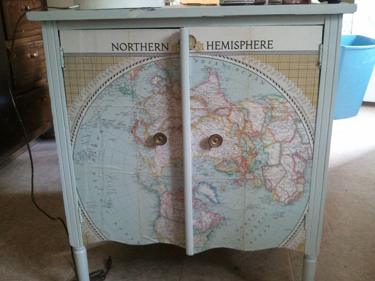 I decoupaged a 1946 National Geographic Map on the front of an old record cabinet.