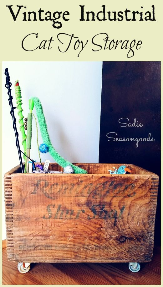 """I needed a better way to store pet toys while keeping with our vintage industrial / primitive home decor. So I took an antique wooden crate, added some salvaged casters / wheels, and built an inside """"pocket"""" to keep their toys neat and tidy. I love to organize with an upcycle / repurpose project! #SadieSeasongoods"""