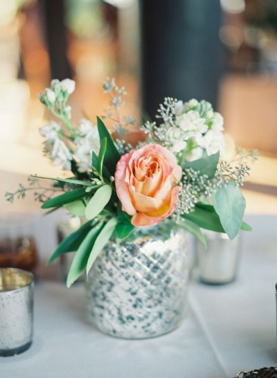 Metallic vases and roses: http://www.stylemepretty.com/little-black-book-blog/2014/12/01/southern-chic-camp-lucy-wedding/ | Photography: Becca Lea - http://beccalea.com/