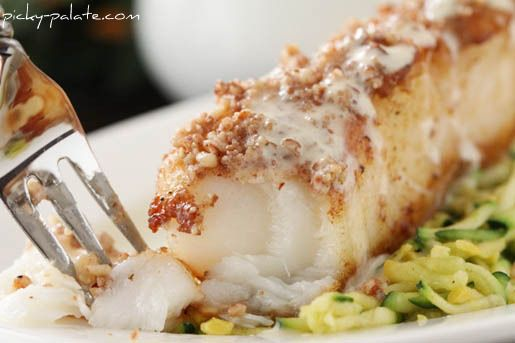 Pecan and Dijon Crusted Chilean Sea Bass Over Zucchini Slaw Hi everyone!  Here is our Mother's Day Celebration Main Course!  Now, I must admit I don't cook seafood very often, but oh baby is this an incredible recipe!! I remember strolling through Whole Foods last week thinking…..I've got to do a seafood dish, something easy …