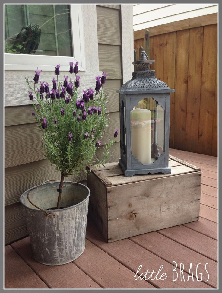 Little Brags: A Lantern Make Over And Our Back Porch.  Painted lantern makeover.....