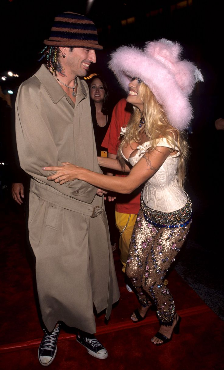 In 1999, Pam wore skinny sequined pants, a bustier top, and a giant pink furry hat. Her then-husband Tommy Lee opted for just a trench coat.