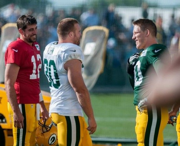 Green Bay Packers teammates Aaron Rodgers (12), John Kuhn (30) and A.J. Hawk (50) joke with one another before training camp practice at Ray Nitschke Field on Thursday, August 1, 2013.Lukas Keapproth/Press Gazette Media