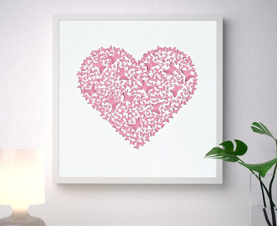 Unique handmade picture, made of more than 300 individually cut and placed 3D pink art paper butterflies forming a classic heart shape, on a