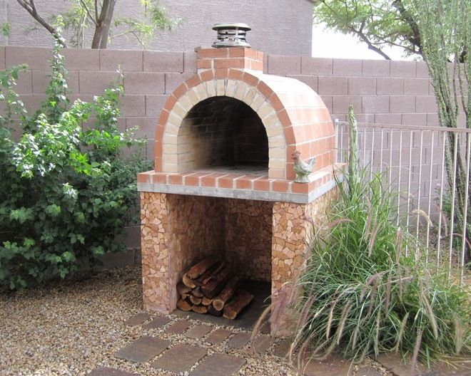 outdoor pizza oven; build the fire at the back then cook pizza at the front once coals are ready