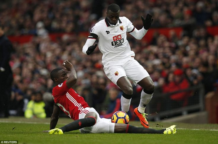 M'Baye Niang, the Watford striker on loan from Milan, is challenged by Manchester United defender Eric Bailly