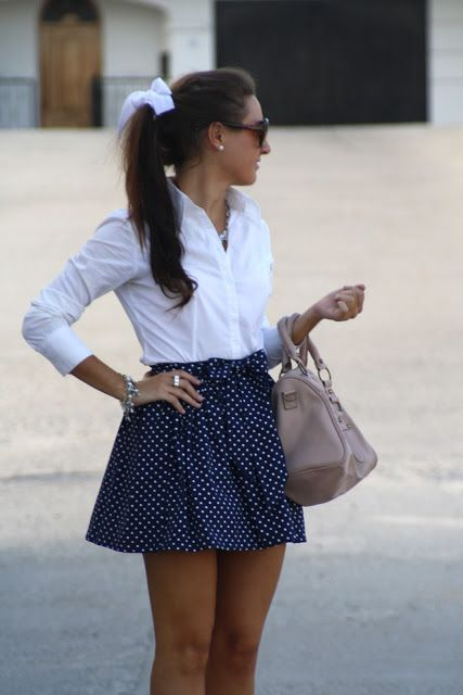 This beautiful skirt is blue with  white polka dot and has a belt with a big bow. The size is medium.The price is $ 420.00