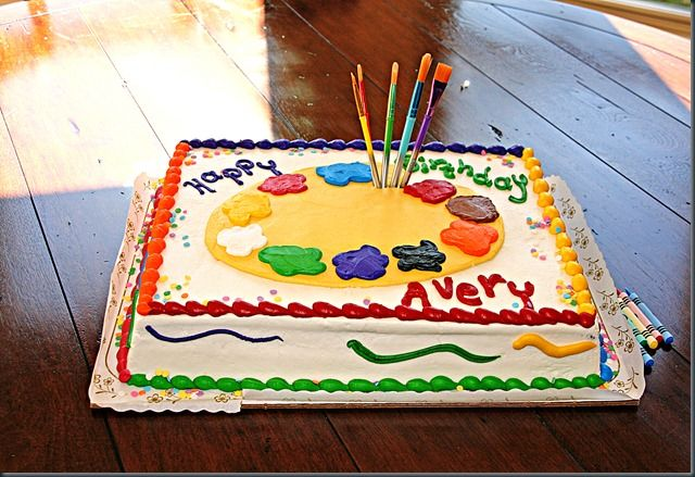 art party cake--cute with real paint brushes coming out of it.
