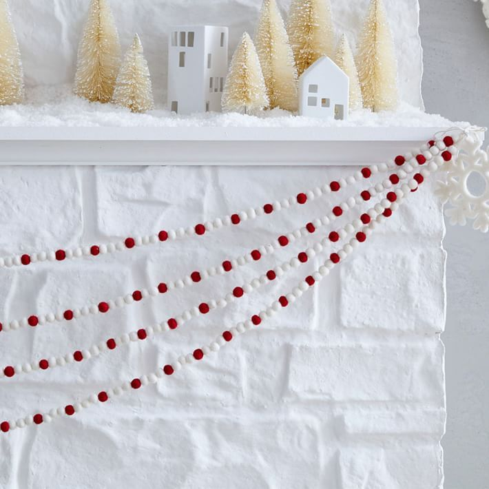 A festive felt strand decks the halls, mantel or tree with holiday cheer. Handcrafted in a Fair Trade Certified facility, this is a great gift!