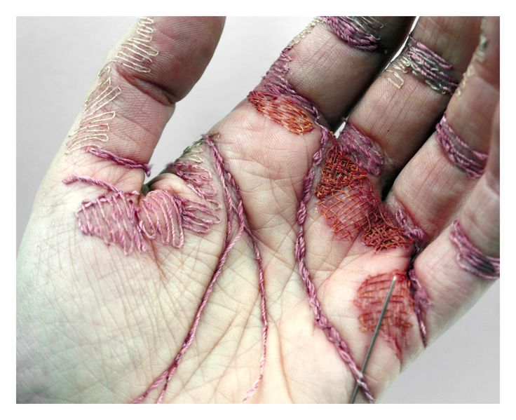 Eliza Bennett embroiders colored thread into her own hand to challenge the idea that work traditionally reserved for women is easy.