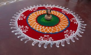 A traditional rangoli design made in houses on festivals in India. http://bit.ly/1VEb6Yy