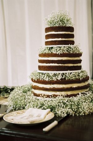 gorgeous 'naked' wedding cake with baby's breath