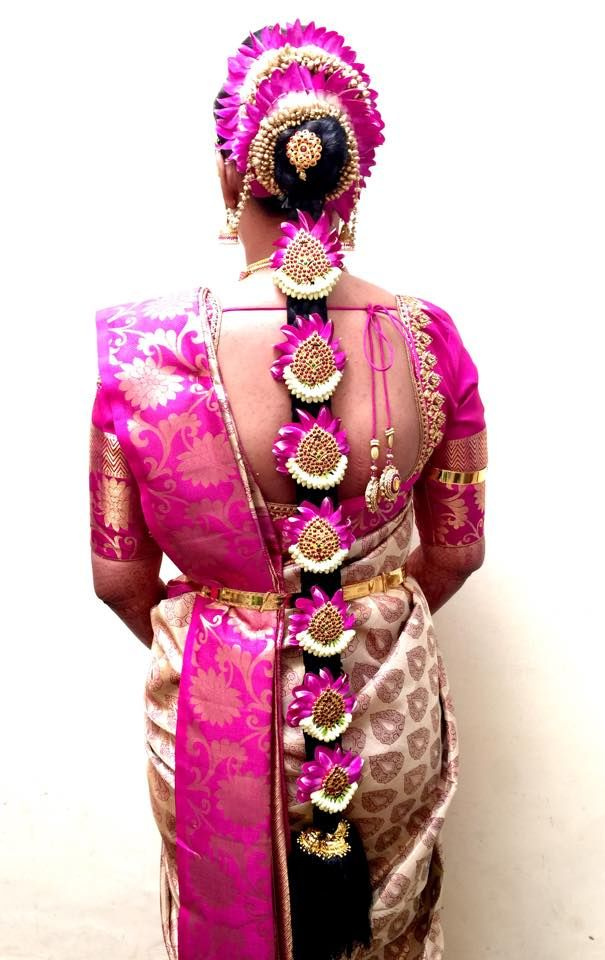 South indian bride. Silk sari. Kanchipuram silk sari. Braid with flowers