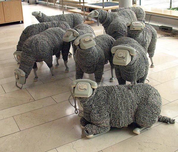 Sheep / Phones ByJean Luc Cornec. The installation consists of 32 sheep that ring from time to time.