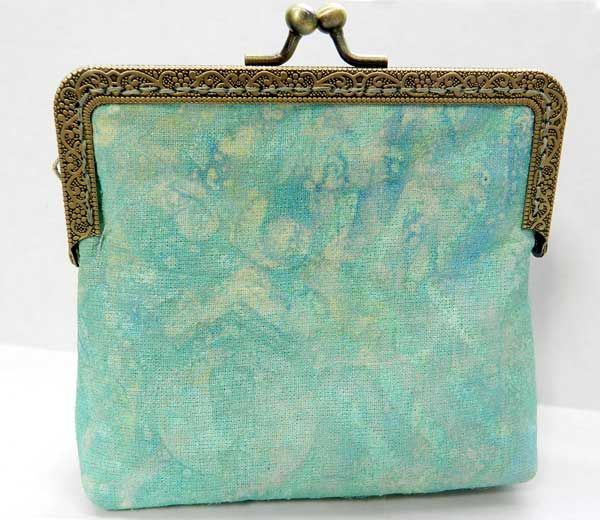 A Gelli print can be subtle too depending on how you use your patterns and colors. I printed a piece of fabric using blues and greens for a layered subtlety that you really have to see in person. And then this is what I created with that fabric. I never made a coin purse before. But I will again!