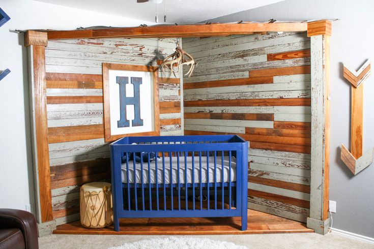 Man Cave Nursery with Blue Crib and Reclaimed Wood Walls - Project Nursery