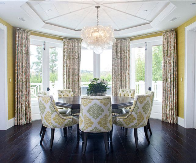 An Octagon Tray Ceiling Sits Over A Circular Shaped Dining Room Clad In Yellow Grasscloth Wallpaper Framing Bay Doors Dressed Floral Curtains