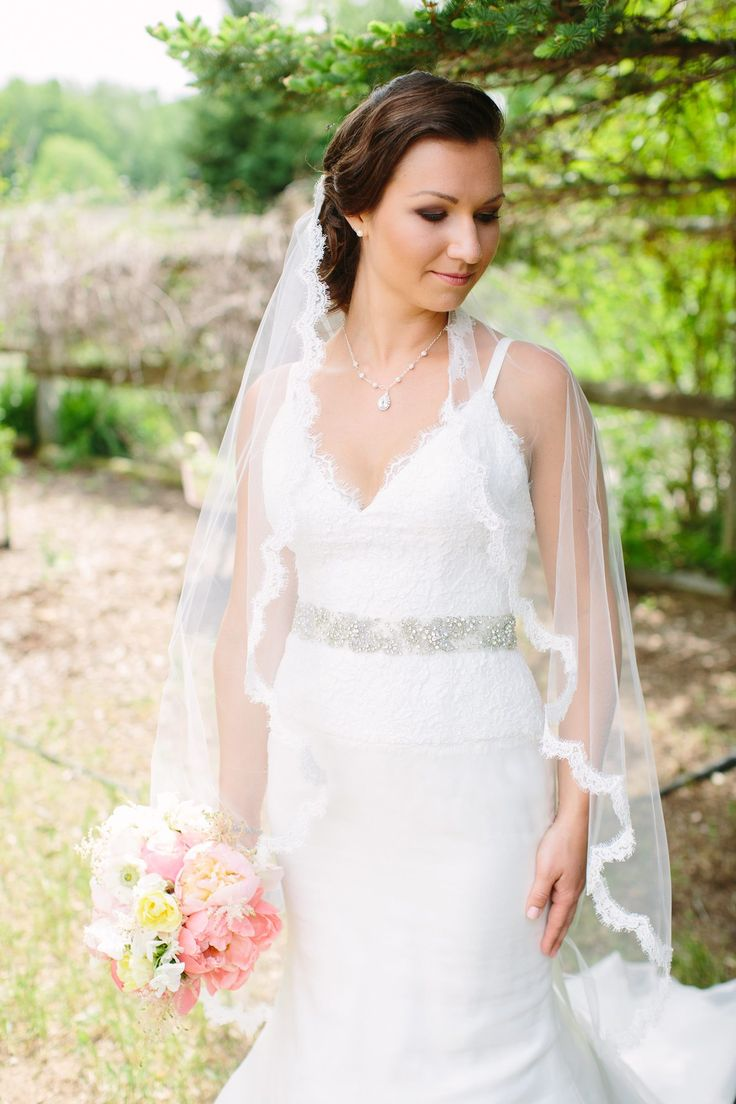The stunning bride donned in a lace-edged veil, carrying a bouquet of beautiful peonies | A Day In May, Event Planning & Design | Northern Michigan Weddings | Traverse City Weddings | Spring Splendor at the Ranch | Snow Moon Ranch, Maple City | Dan Stewart Photography