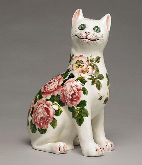 Wemyss Ware seated cat figurine, decorated throughout with large cabbage roses and small dog roses