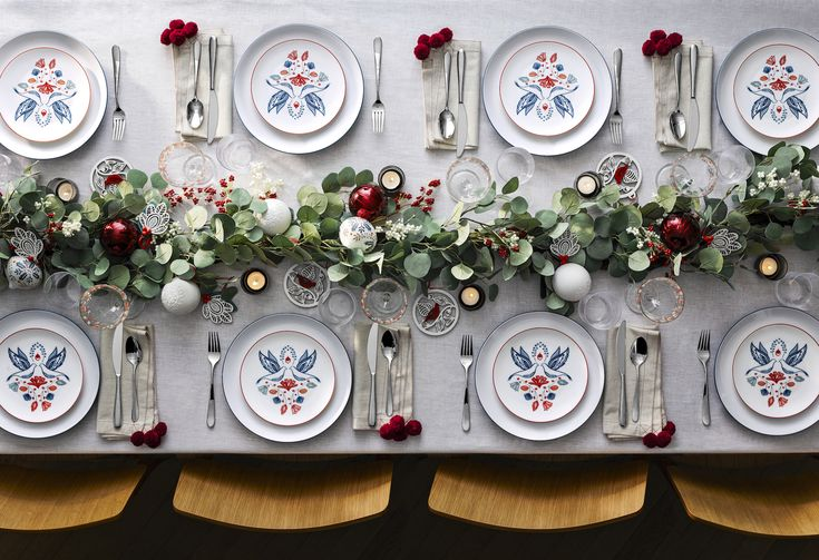 Dinnerware is thoughtfully painted so as to reveal a festive design once the turkey has been tucked into, inviting a closer look and a touch of curiosity even when dinner has finished.