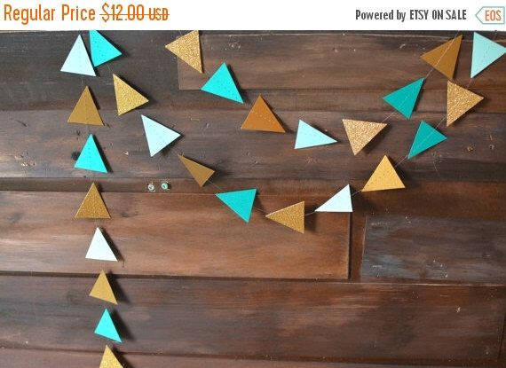 ON SALE Teal, Blue, Antique Gold, Gold Glitter Woodlands Tribal Triangle Garland, Geometric Pow Wow Garland for Backdrops, Nurseries, Partie by PartyMadePretty on Etsy https://www.etsy.com/listing/466606034/on-sale-teal-blue-antique-gold-gold