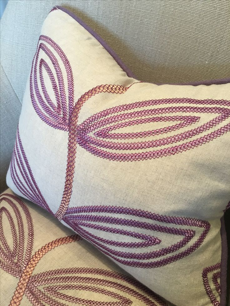 Embroidered fabric coupled with a warm wool on our Pollyanna chair in the showroom