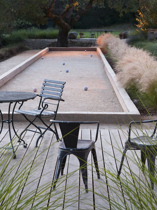 Italian Bocce court - fabulous planting of grasses around decking