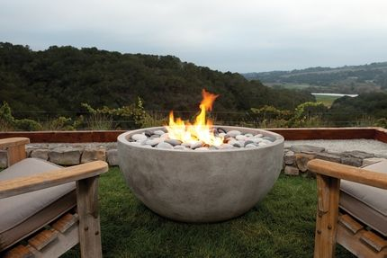 """Simple fire bowl The Infinite Artisan Fire Bowl from Eldorado Stone. Available in 4 colors and 2 finish options. 36""""w, 19""""h, 350 lbs. Natural gas for $2600, liquid propane for $2650. """"As the name implies the Infinite is limitless in its design applications. The simple yet elegant shape will naturally draw attention for its style and inviting warmth."""""""