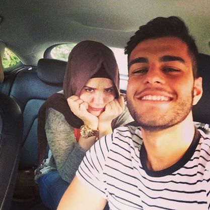 She said: let me hold the camera. He said: no I'll do it. She said: fine I won't smile. He said: ok do whatever you want.