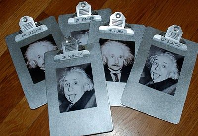 Clip Boards with the famous Einstein's tongue picture... a fun touch!