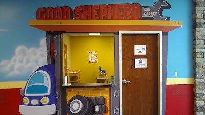 """Worlds of Wow -the """"Good Shepherd Garage"""", one of several themed classroom entrances at Journey Church in Norman, OK."""