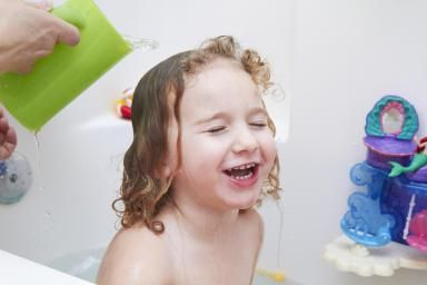 A three year old girl in the bath tub. - Jena Cumbo/Taxi/Getty Images