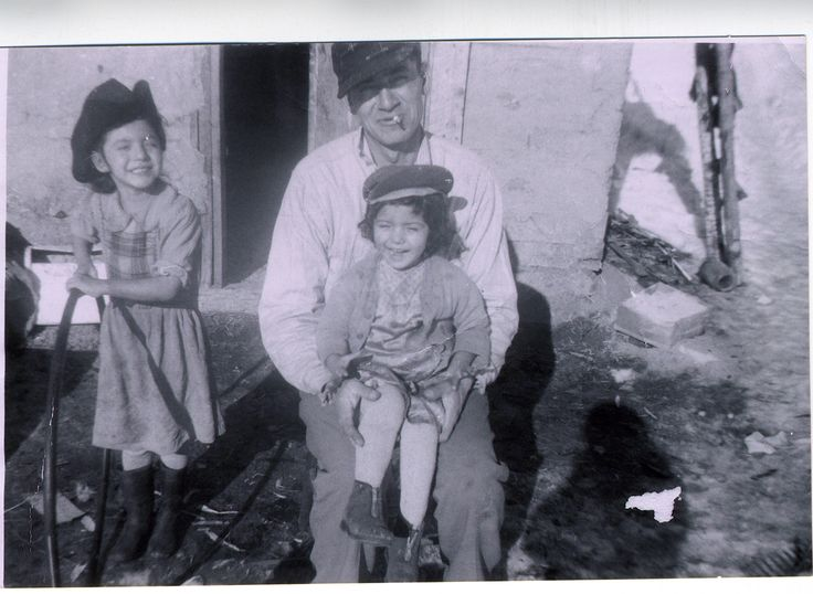 Picture of Louise Halfe in the cowboy hat, with her father holding June Martha Half