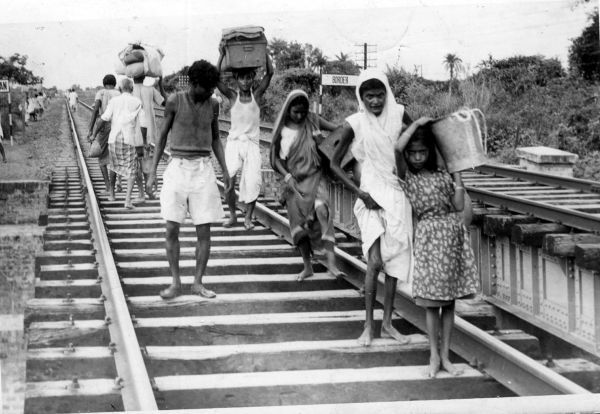 Sometime in 1947, refugees from East Pakistan arrive barefoot in India during the partition. This shot speaks volumes about their grief.