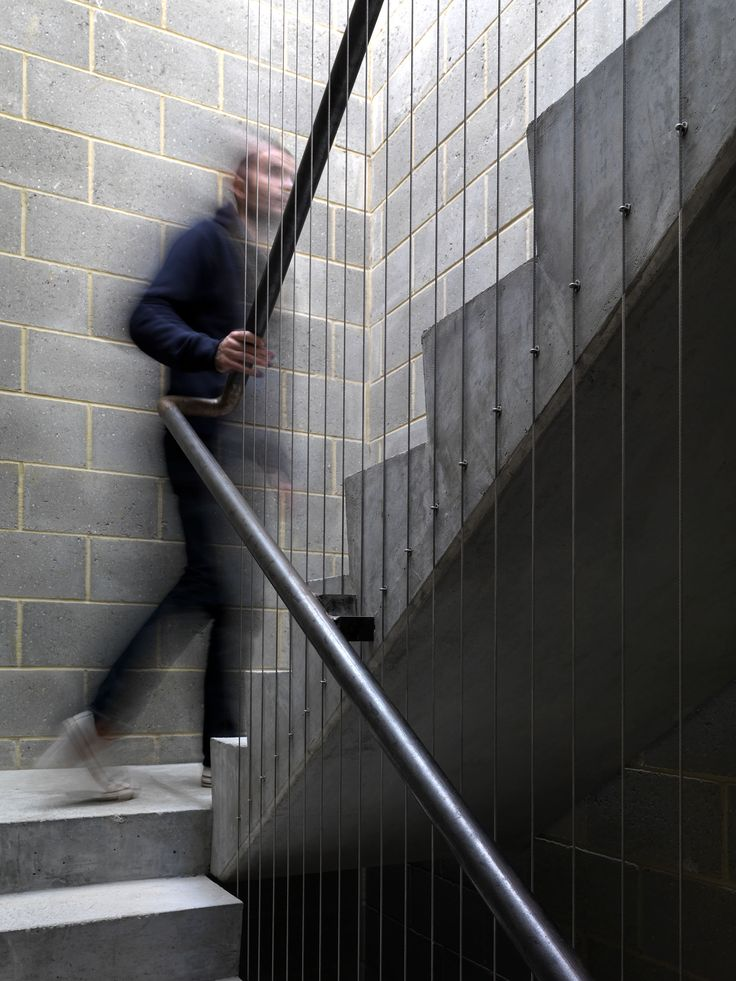 Ada Street concrete stair with steel stringer balustrade