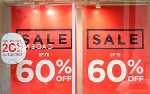 A shop window display advertising sale reductions