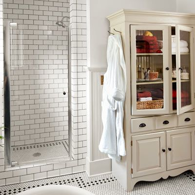 A little-used linen closet became a shower stall lined with subway tile and fitted with a glass door in this budget bathroom redo. | Photo: Nathan Kirkman | thisoldhouse.com