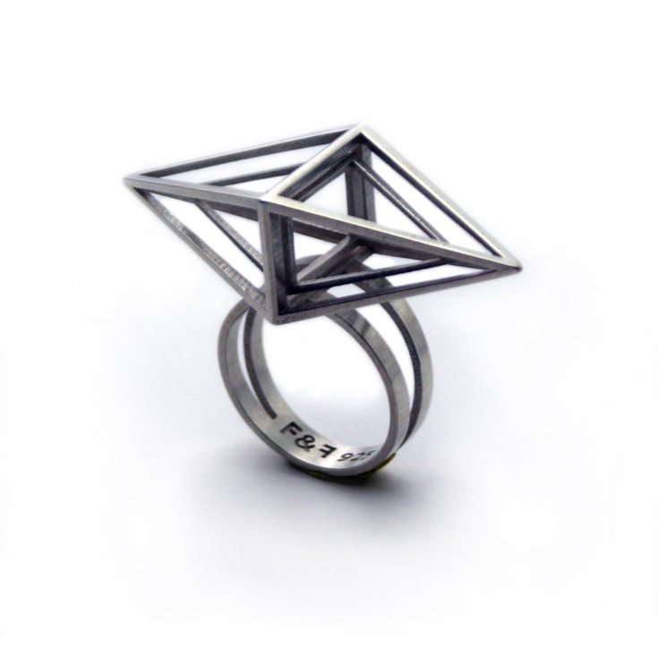Lost wax cast in sterling silver, this ring is defined by one caged diamond shape within another.   Dimensions: 0.7 w x 1.9 l x 1.3 h. Ring may be custom sized. Please contact the store directly for details  Sizes available: 5, 9 Price $140.00
