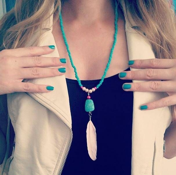 You can buy all the beads and materials for this bohemian feather necklace at www.BeadsandBasics.com