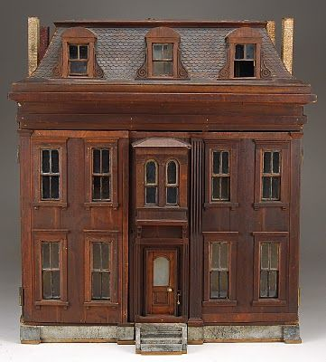Highly sought after examples in Gerry Gaba's estate collection of dollhouses included a gorgeous Mansard roof Dutch dollhouse with stone foundation and classic styling. This stunning abode sold for $8,625 against a $5,000-7,500 estimate http://antiquedaisy.blogspot.com/2010/04/secrets-and-shabby-habits.html