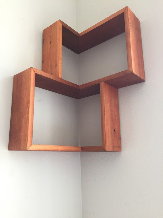 Different. Fun. Abstract. This little bookshelf and/or picture frame shelving is sure to impress. Limited on space? This is the perfect shelving