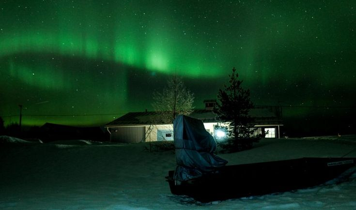 Miekojärvi fishing harbour in Pello in Lapland under northern lights