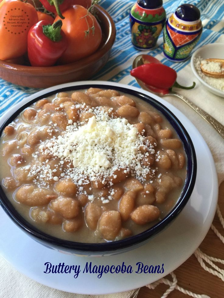Buttery mayocoba beans garnished with cotija cheese