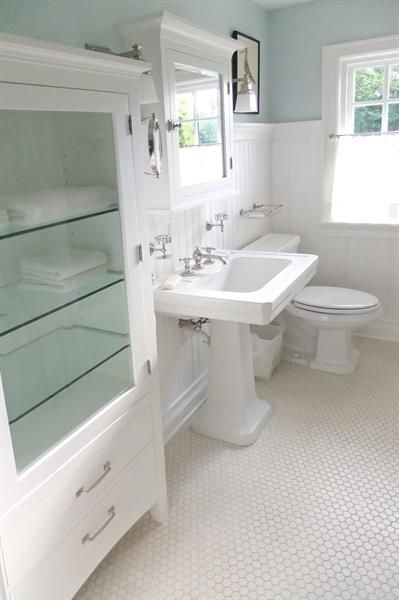 Great storage cabinet and love the bathroom classic look.