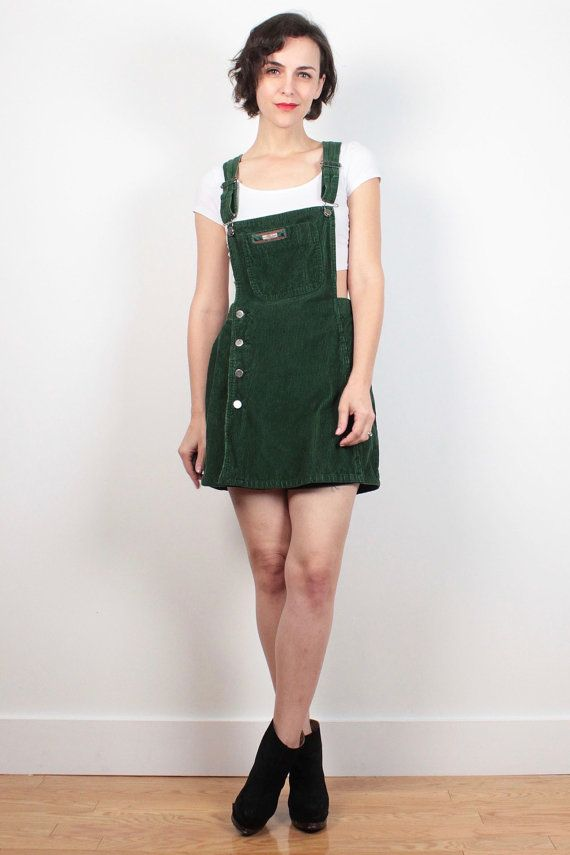 Vintage romper. Dark green corduroy. Unlined. Adjustable shoulder straps. Button skirt front. Inside (hidden) metal zipper shorts front. White shirt worn underneath not included. Mini length. *some light fading throughout. Shoulder Width: Bust: Waist: 30 Hips: 38 Length: 32.5 as shown on model Inseam: 4.5 Tag: Squeeze jeans. US 9/10. 100% cotton Fits Like: S/M Accessories are not included unless listed in the item description For reference the model is 57, and a US size 4/6. **PAYMEN...