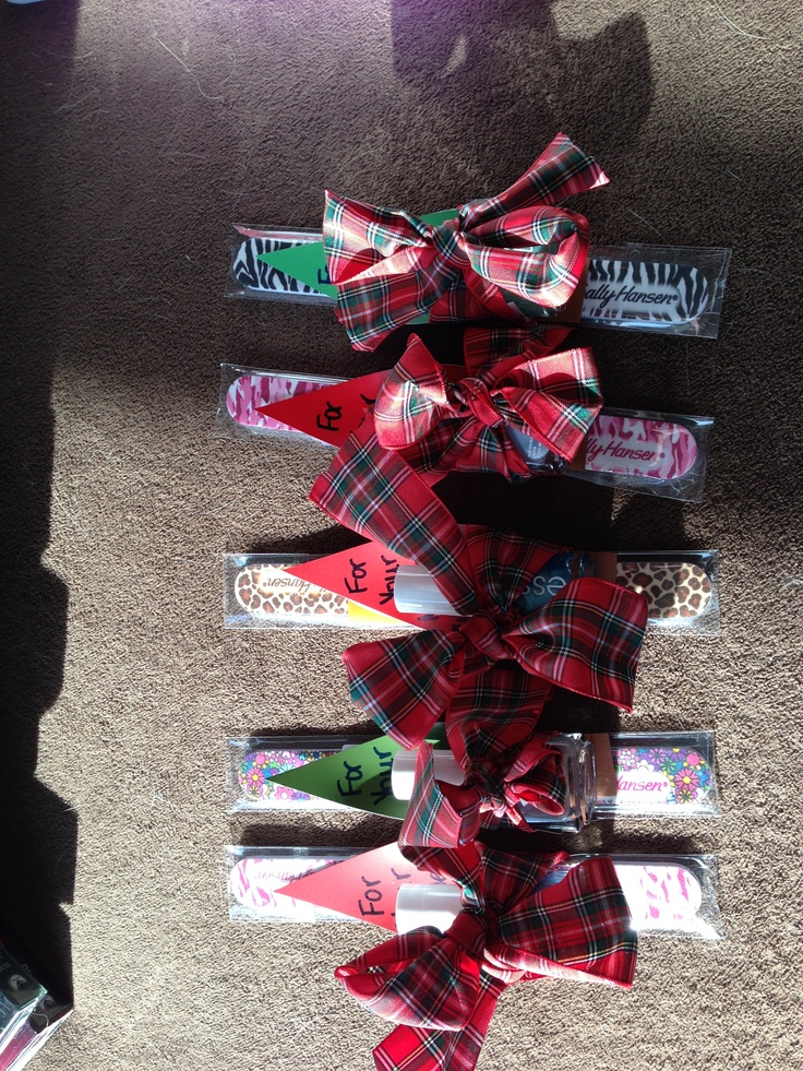"""For your mistle""""toes"""" :) co-worker gifts consisting of Essie nail polish, an emery board and a paint chip cut into a Christmas tree all tied together with a ribbon :-)"""