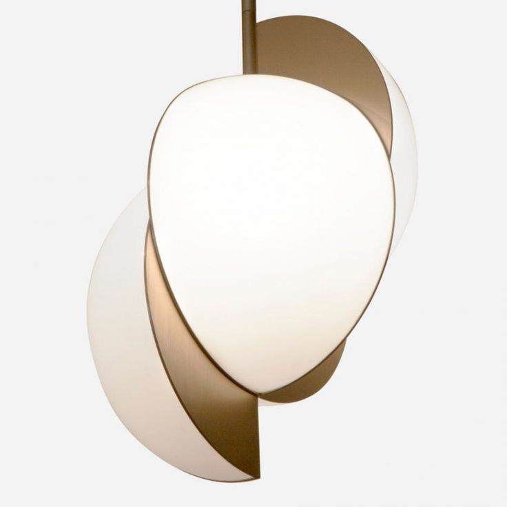 British jewellery designer Lara Bohinc has branched into lighting with a collection of lamps made from broken spheres.