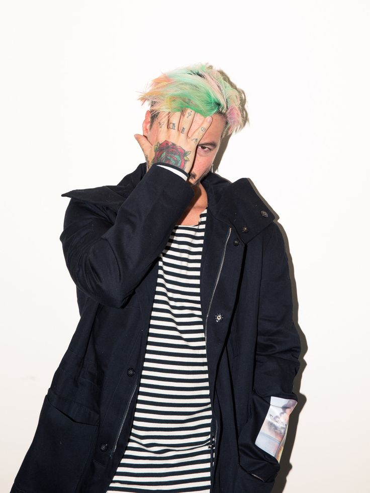 """Inside J Balvin's Closet: """"When you do what you love, it's not work anymore. [This week in New York] I'm going to see what I love, see clothes, and to say hi to all of these designers that I love. Being with Mike [Camargo], who is one of my best friends in life [laughter], and is just amazing. He's real and he's humble.""""  --Jacket, Raf Simons; Shirt, Fear of God. 