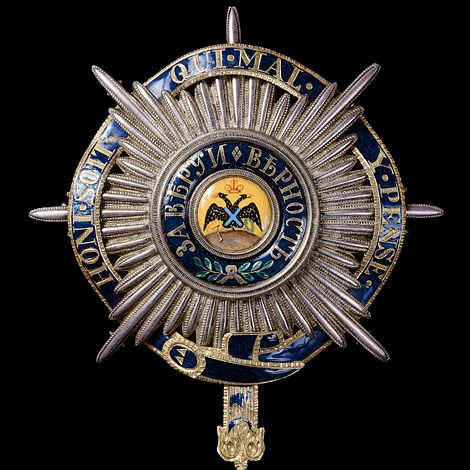 The Russian Order of St. Andrew the Apostle the First-Called with motto band of the British Order of the Garter.