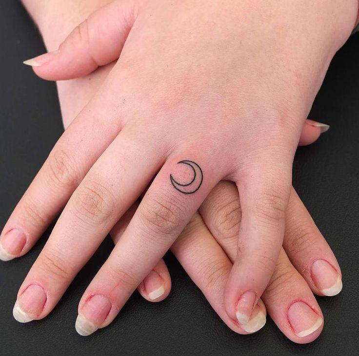 Moon finger tattoo